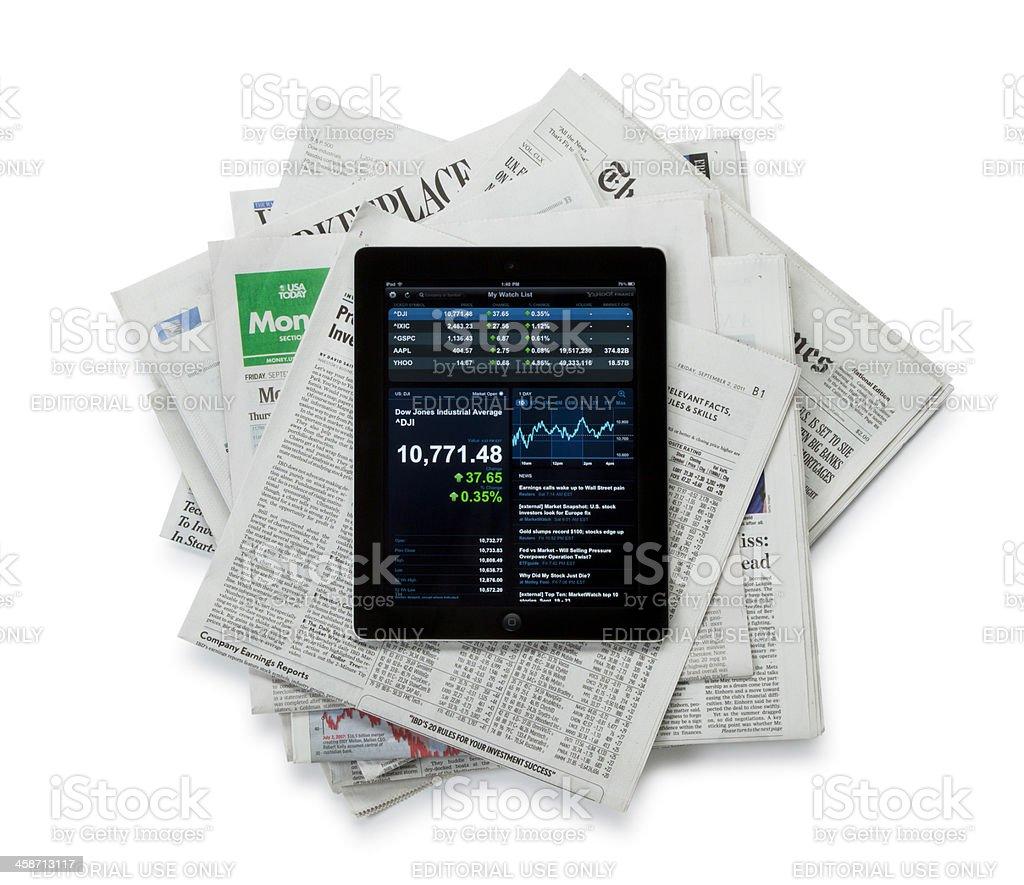 Apple iPad II on Top of Newspapers stock photo