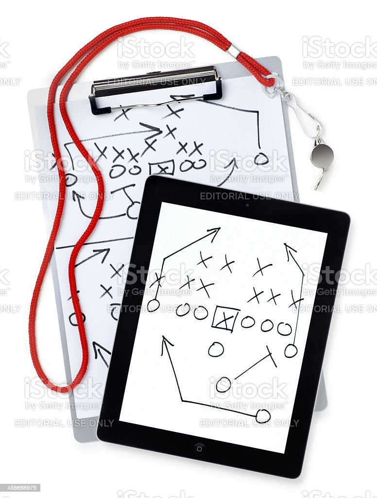 Apple iPad II with Football Playbook on White stock photo
