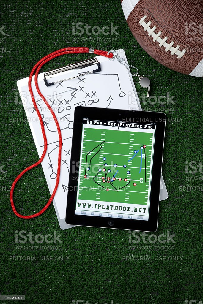 Apple iPad II with Football Playbook on White stock photo