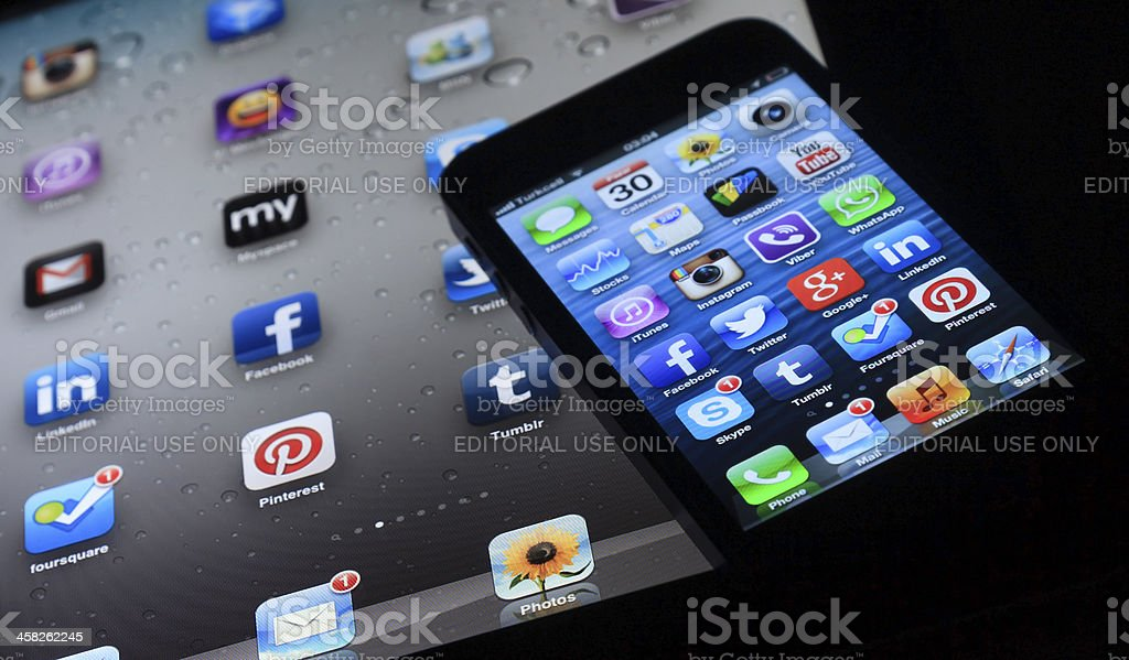 Apple iPad & iPhone 4S screens apps royalty-free stock photo