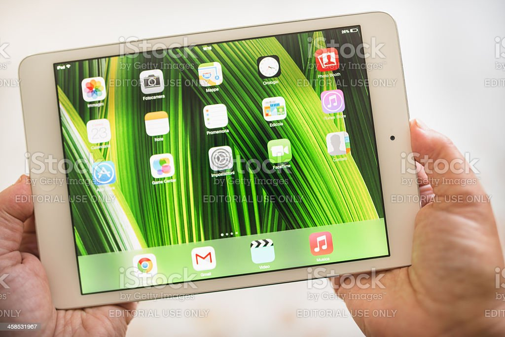 Apple ipad mini wih new IOS 7 os royalty-free stock photo