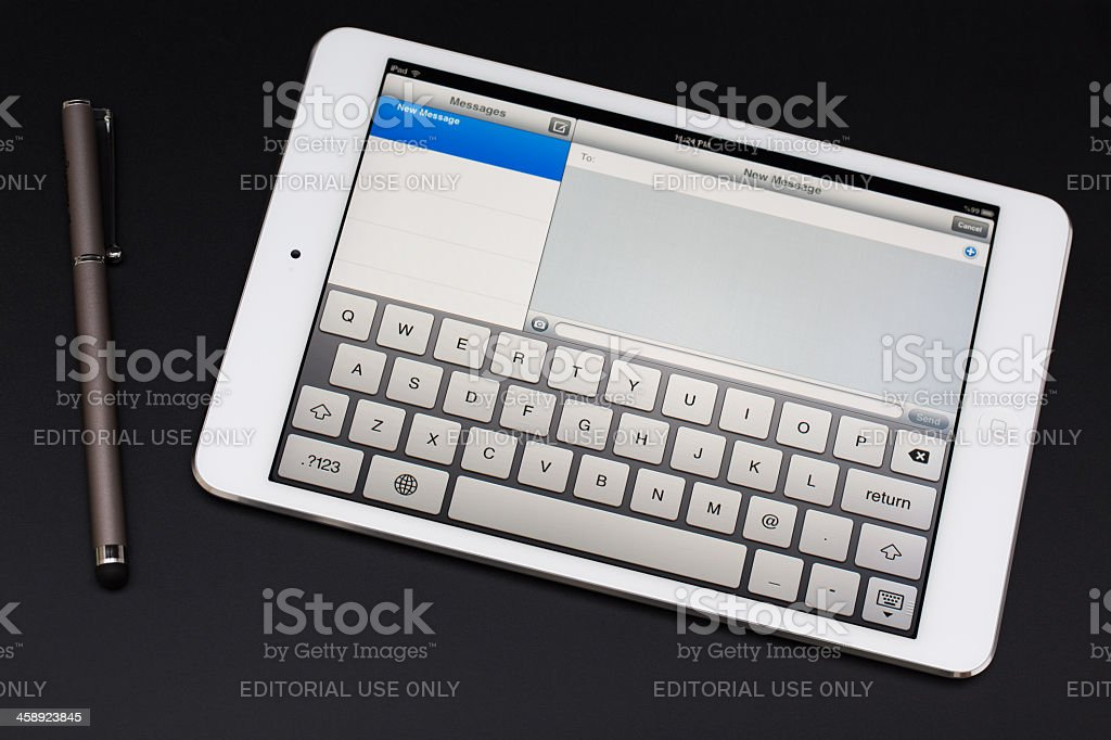Apple iPad Mini with new message screen. royalty-free stock photo