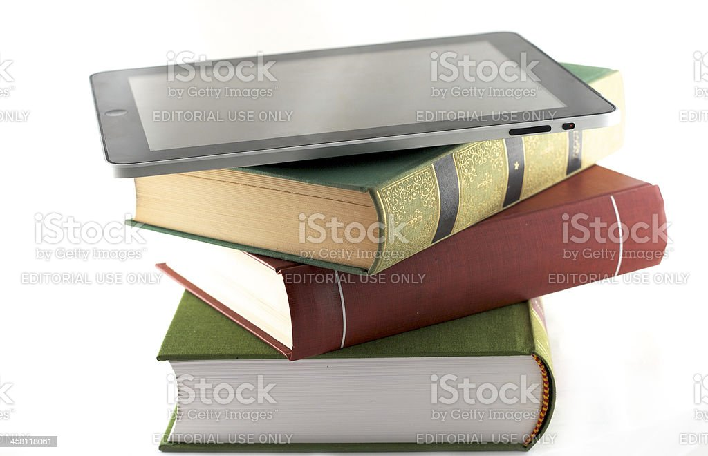 Apple Ipad on a stack of books royalty-free stock photo
