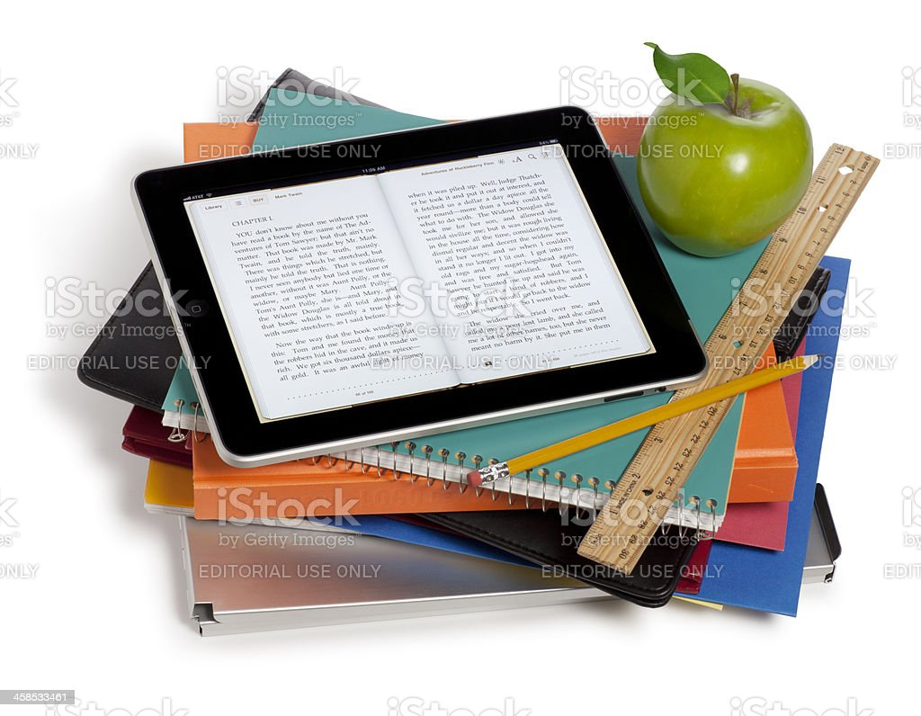 Apple iPad on a Stack of Books stock photo
