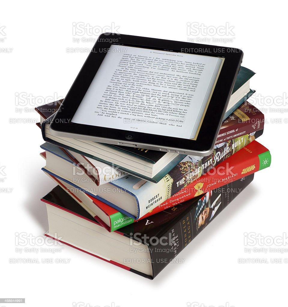 Apple iPad on Top of Books stock photo