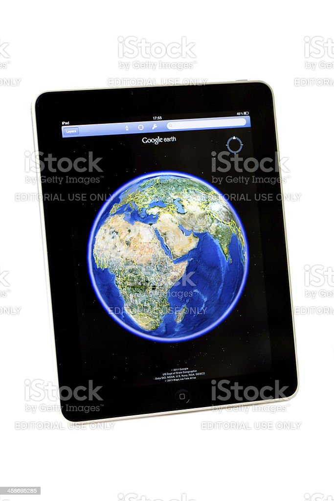 Apple Ipad tablet .. picture of Google earth on screen stock photo
