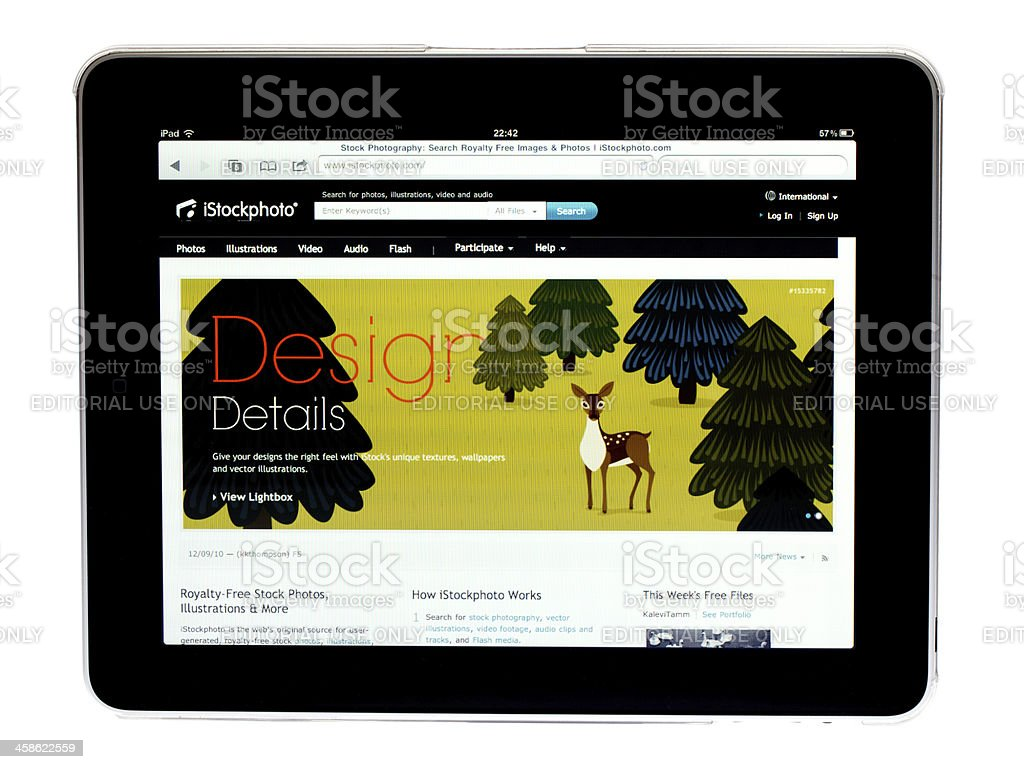 Apple Ipad tablet ..picture of Istockphoto site on screen stock photo