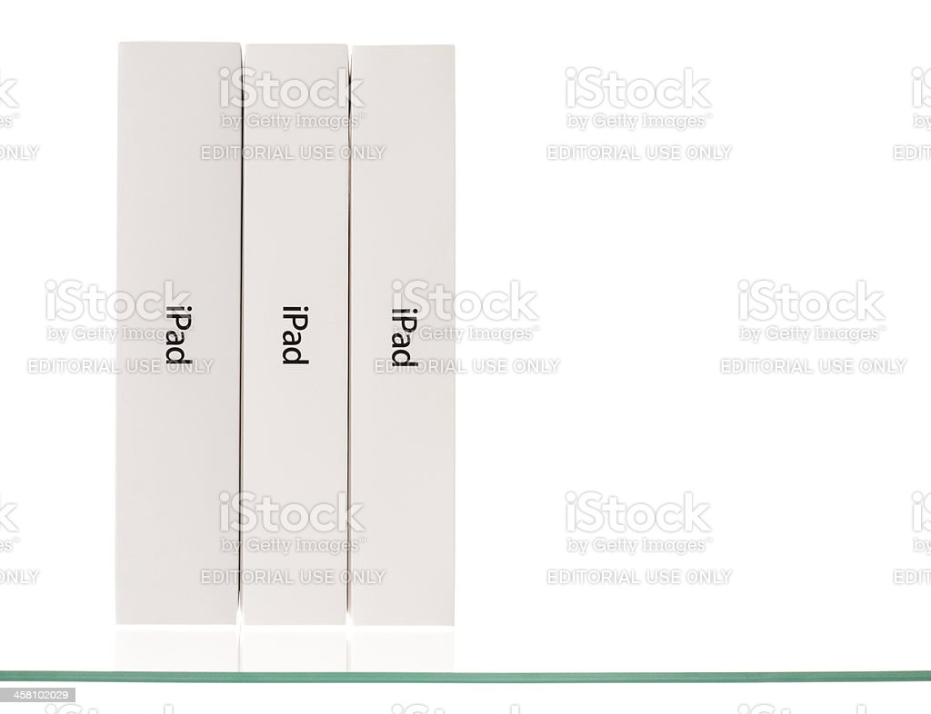 Apple iPad, versions 1 and 2, boxes on glass shelf stock photo