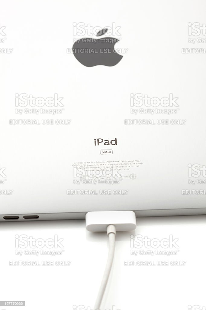 Apple iPad with Battery Charger royalty-free stock photo