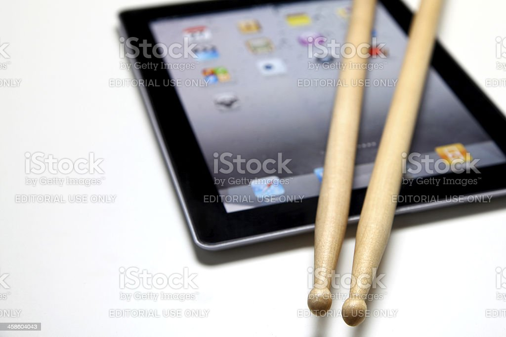 Apple iPad with drum sticks royalty-free stock photo