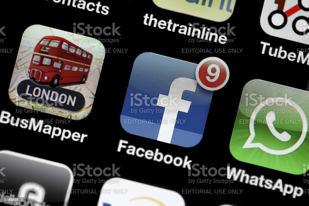 Apple iPhone 4 Facebook royalty-free stock photo