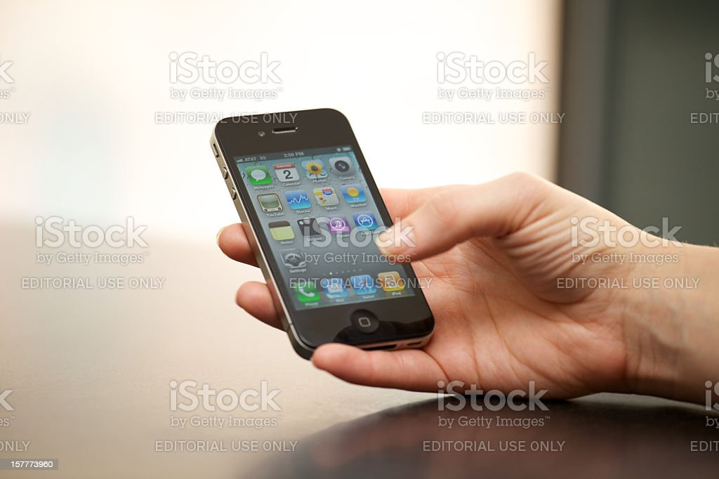Apple iPhone 4 In a Woman's Hand royalty-free stock photo
