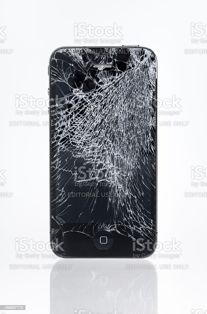 Apple iPhone 4 with crashed screen royalty-free stock photo