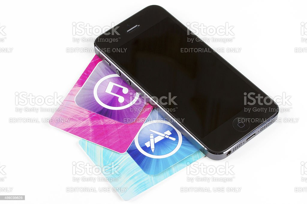 Apple iPhone 4S and iTunes Store cards stock photo