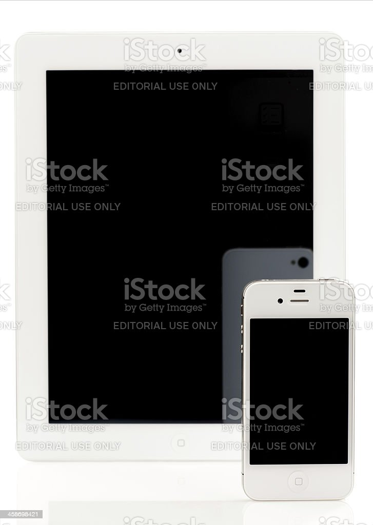 Apple iPhone 4S in front of iPad 2, both White royalty-free stock photo