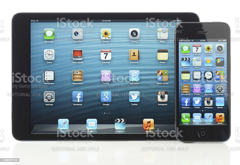 Apple iPhone 5 and iPad Mini black royalty-free stock photo