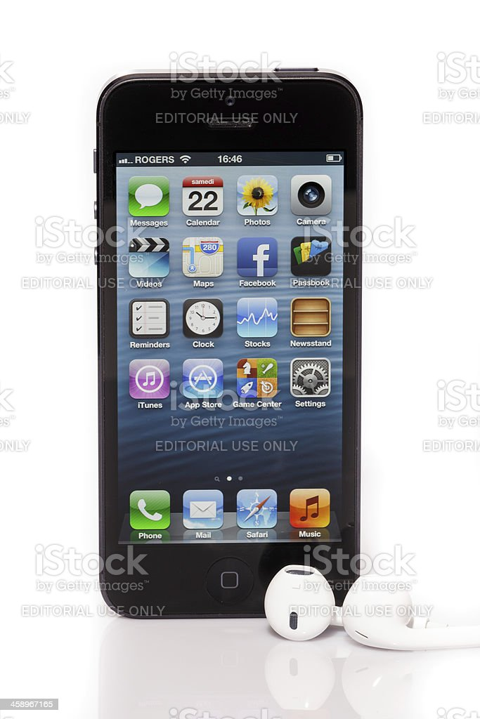 Apple iPhone 5 Home Screen and Earpods Isolated on White royalty-free stock photo