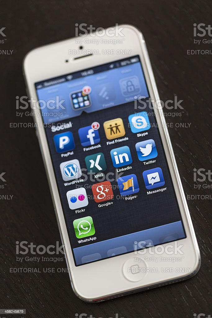 Apple iPhone 5, Social folder royalty-free stock photo