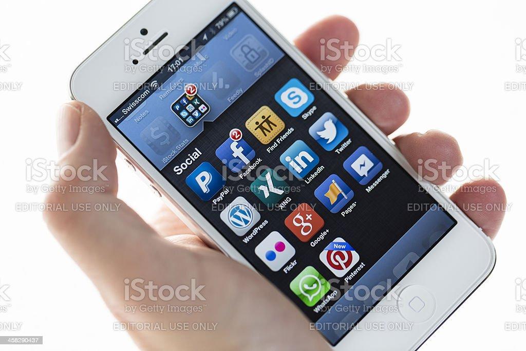 Apple iPhone 5, Social folder royalty-free stock photo