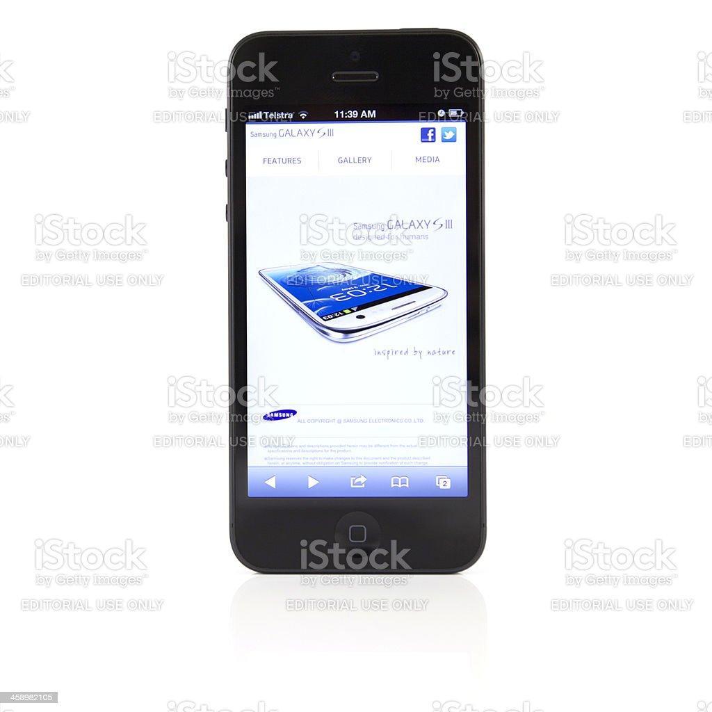 Apple iPhone 5 v Samsung Galaxy SIII stock photo