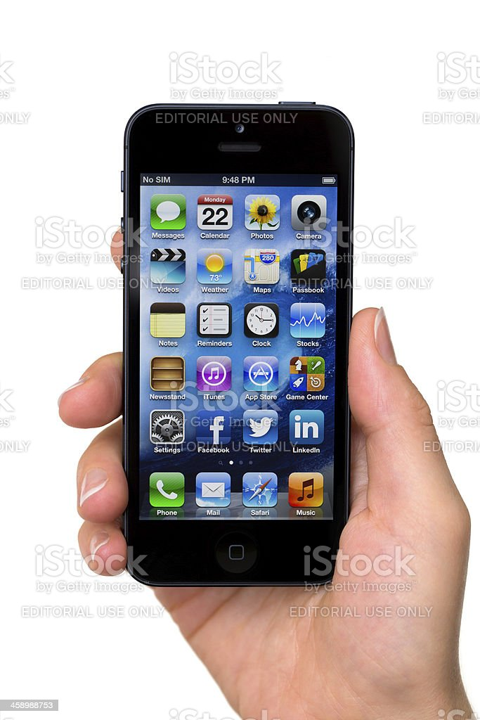 Apple iPhone 5 with Home Screen royalty-free stock photo