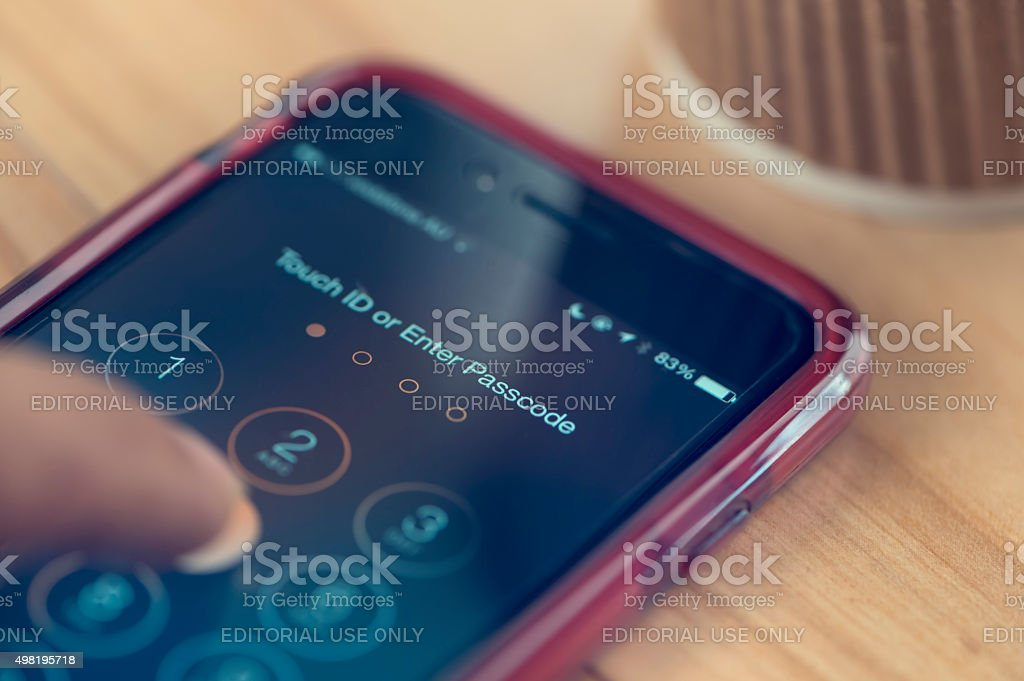 Apple iphone 6 on a table showing passcode. stock photo