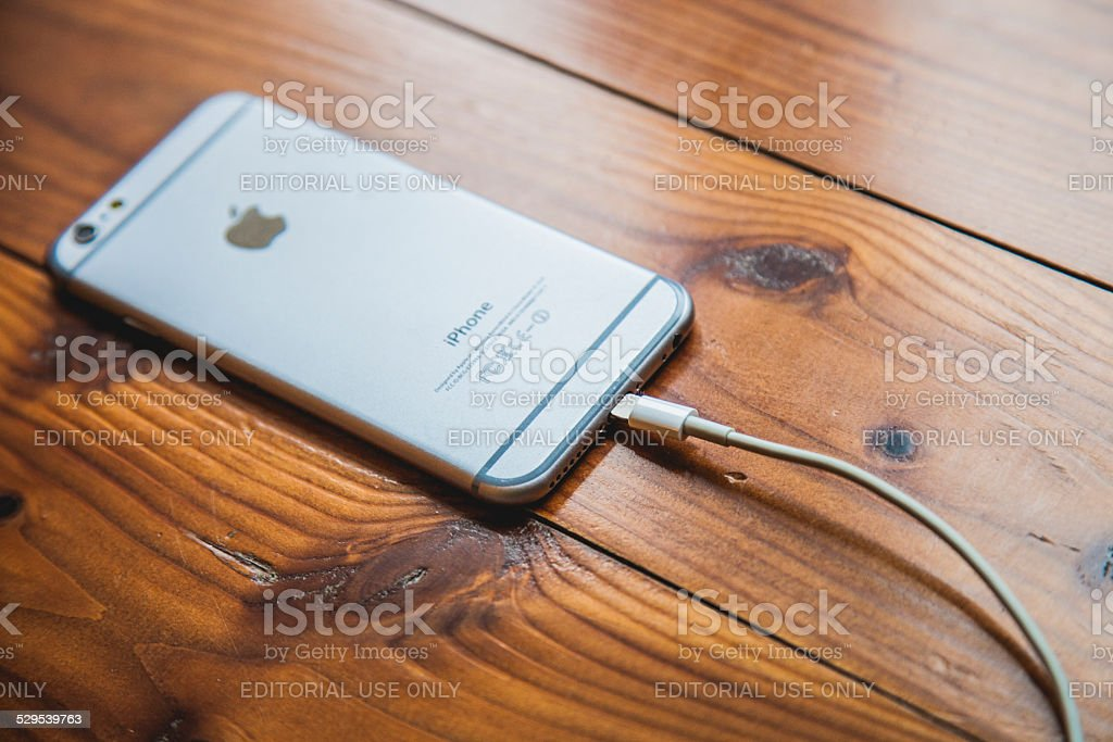 Apple iPhone 6 Silver backside and charger cable stock photo