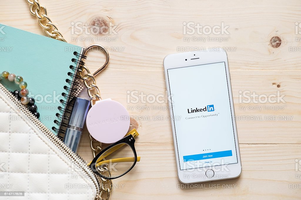 Apple iPhone 6s plus Showing Linkedin application on the screen. stock photo