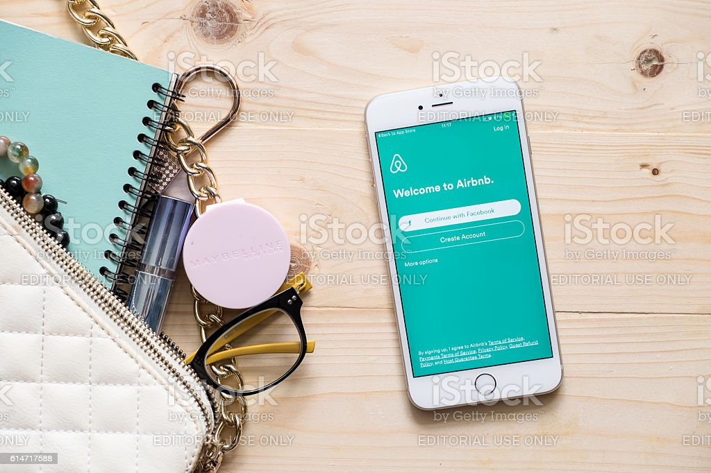 Apple iPhone 6s plus with Airbnb application on the screen. stock photo