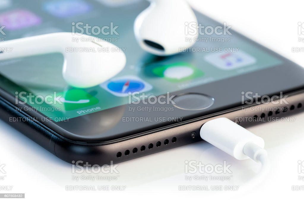 Apple iPhone 7 Plus Home Screen and New Headphones stock photo