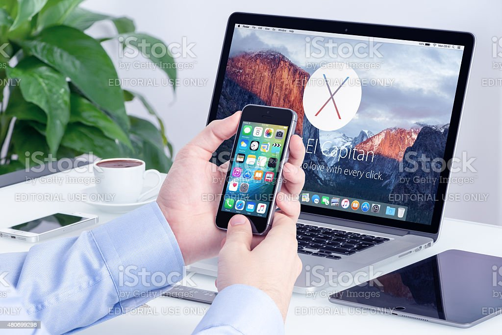 Apple iPhone and Macbook Pro with OS X El Capitan stock photo