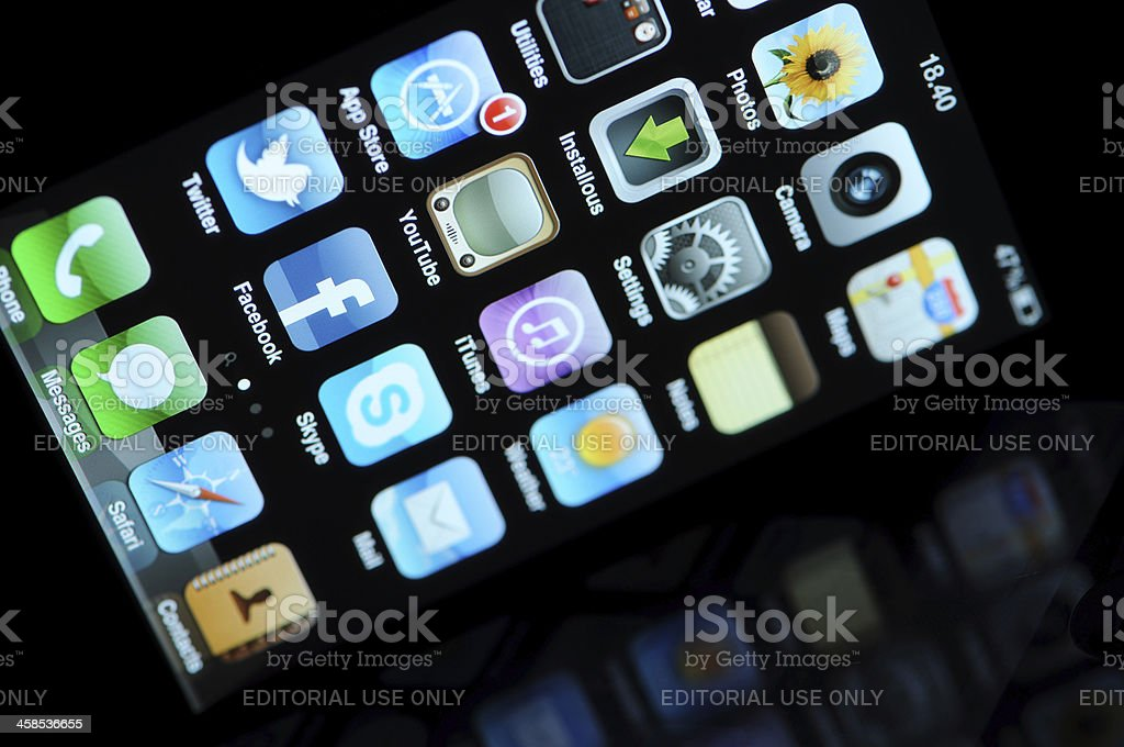 Apple iPhone illuminated home screen. royalty-free stock photo