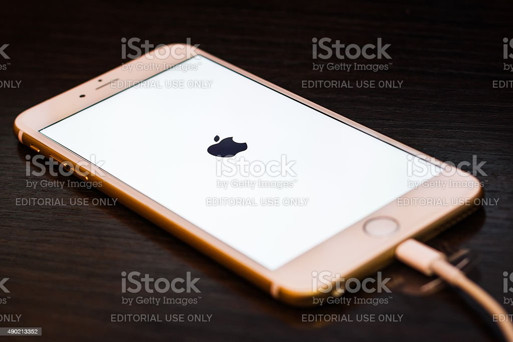 Apple iphone6 with the charging cable on stock photo