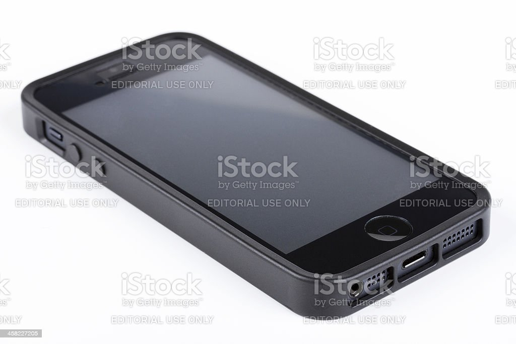 Apple iPhones 5 with case and protective film royalty-free stock photo