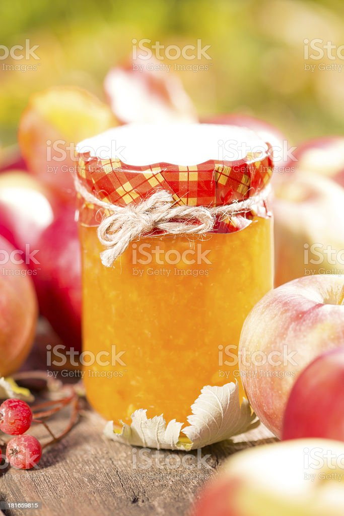 Apple jam and fruits on wooden table royalty-free stock photo
