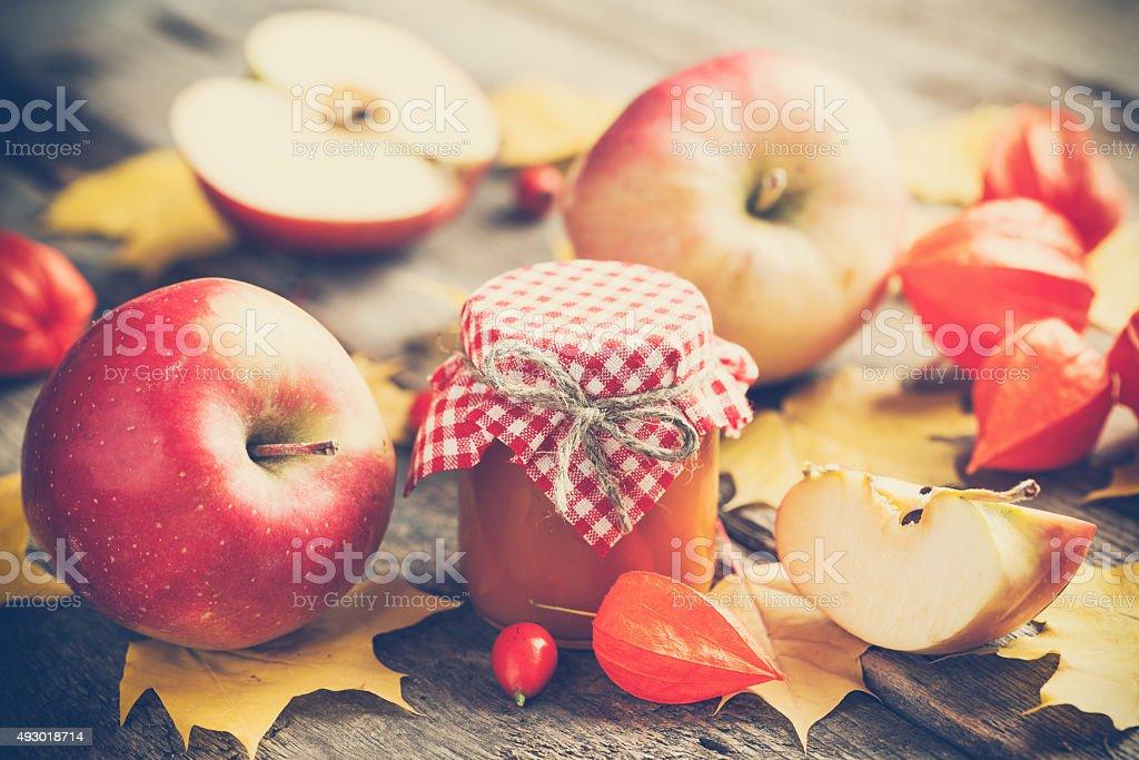 Apple jam in jar and apple fruits. Autumn still life. stock photo