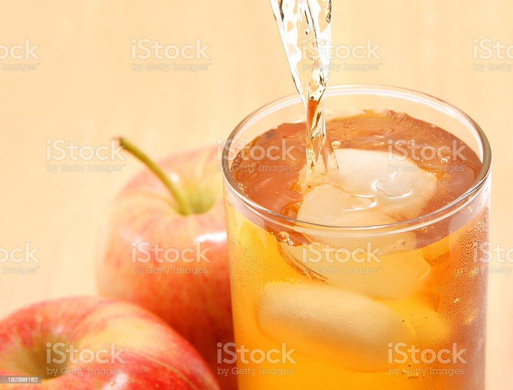 Apple juice being poured into a glass stock photo