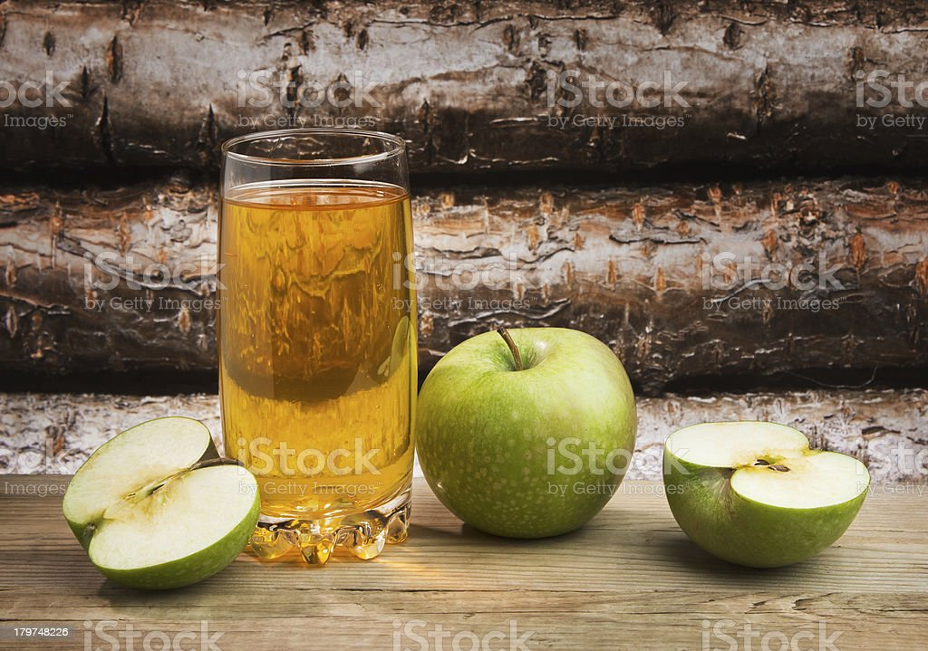 Apple juice in a glass on table royalty-free stock photo