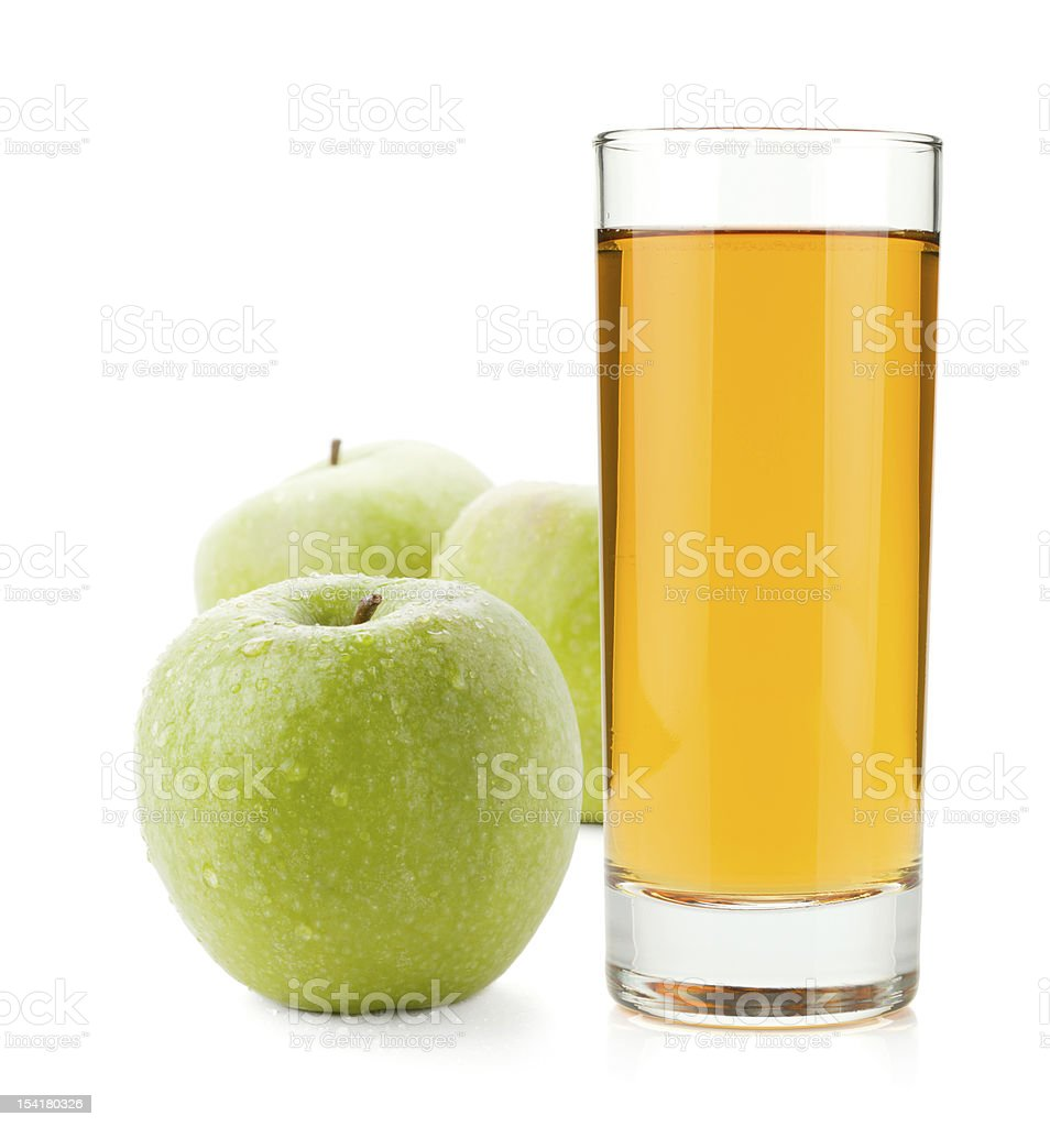Apple juice in glass and green apples stock photo