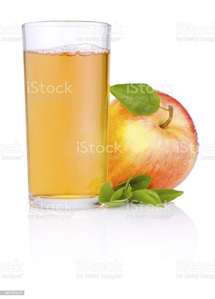 Apple juice in glass and Red juicy apples with leaf stock photo