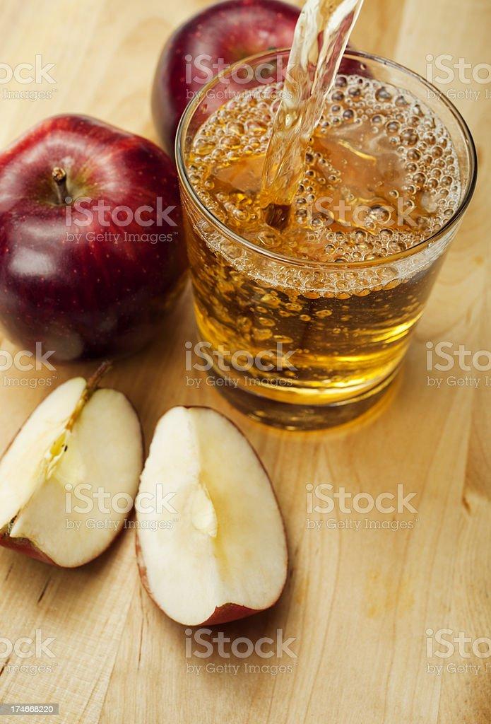 Apple Juice Pouring stock photo