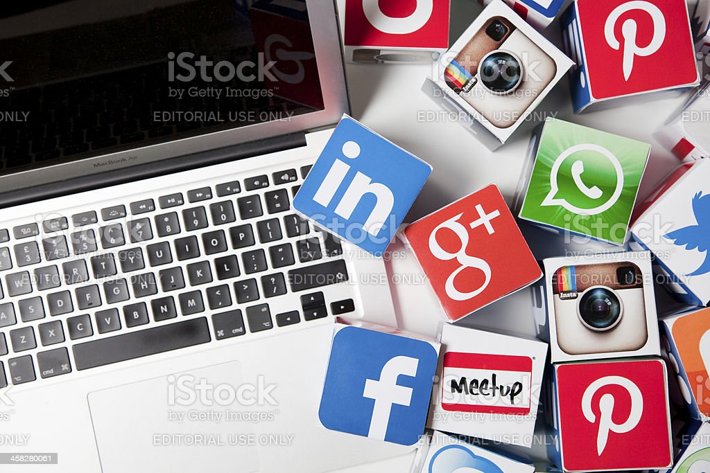Apple laptop with social media icons stock photo