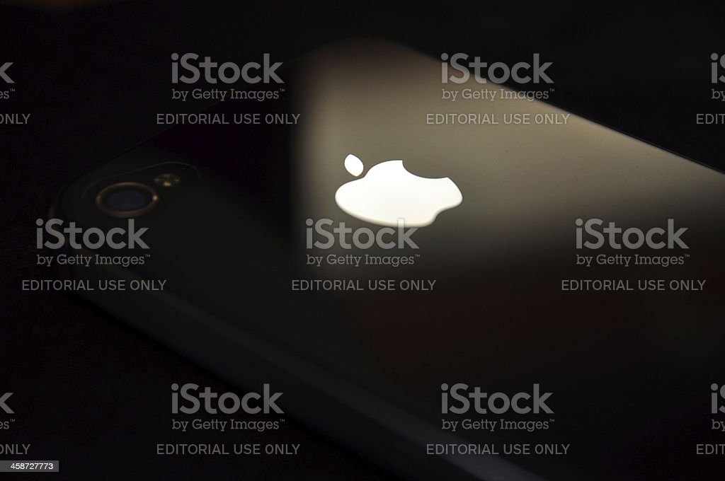 Apple logo in iPhone 4/4s, black background stock photo