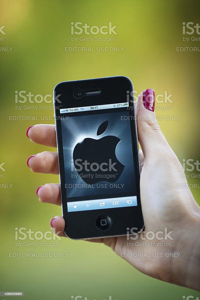 Apple logo on Iphone 4 stock photo