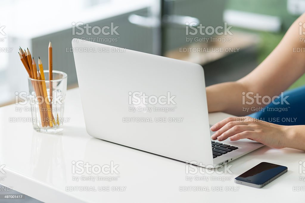 Apple MacBook Air at the desk stock photo