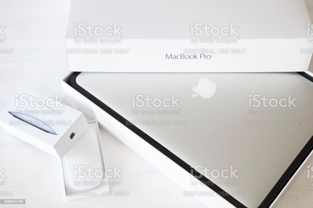 Apple MacBook Pro. and Apple magic mouse 2 stock photo
