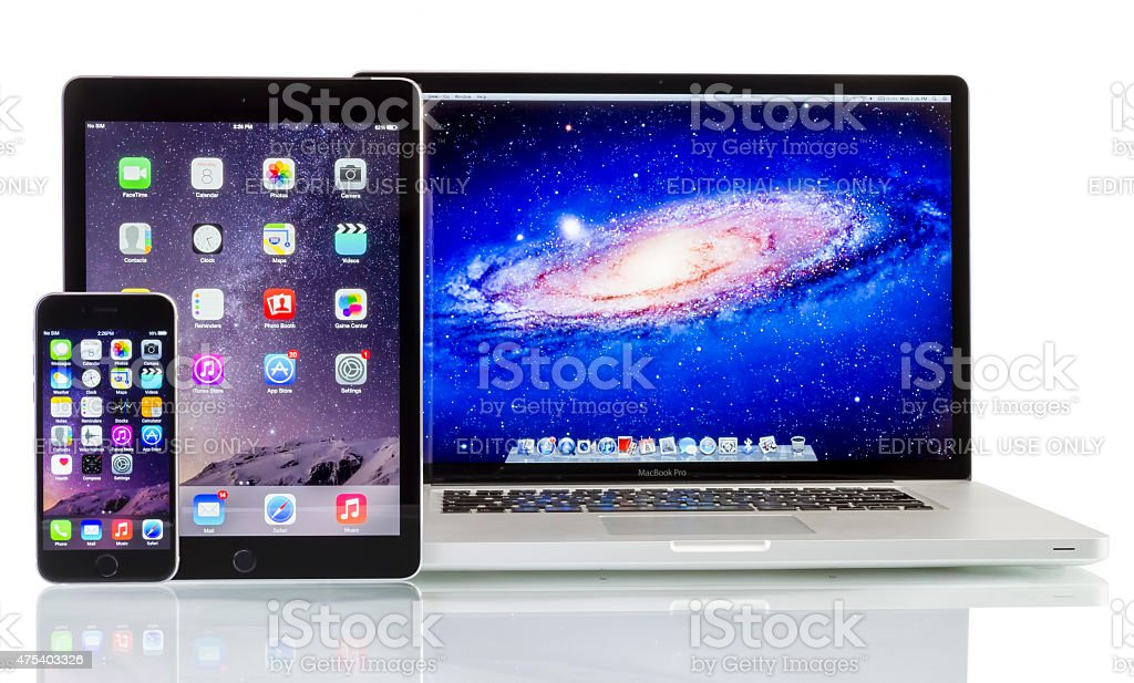 Apple Macbook Pro, iPad Air 2 and iPhone 6 stock photo