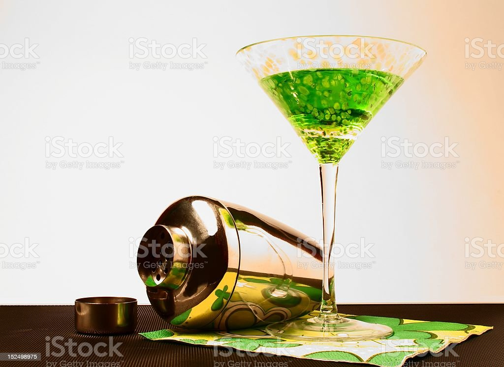 apple martini in a glass with shaker on  bar top stock photo