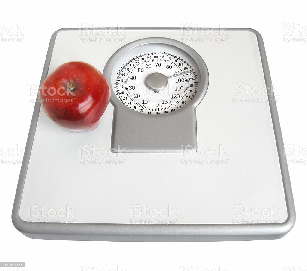 Apple on a Scale royalty-free stock photo
