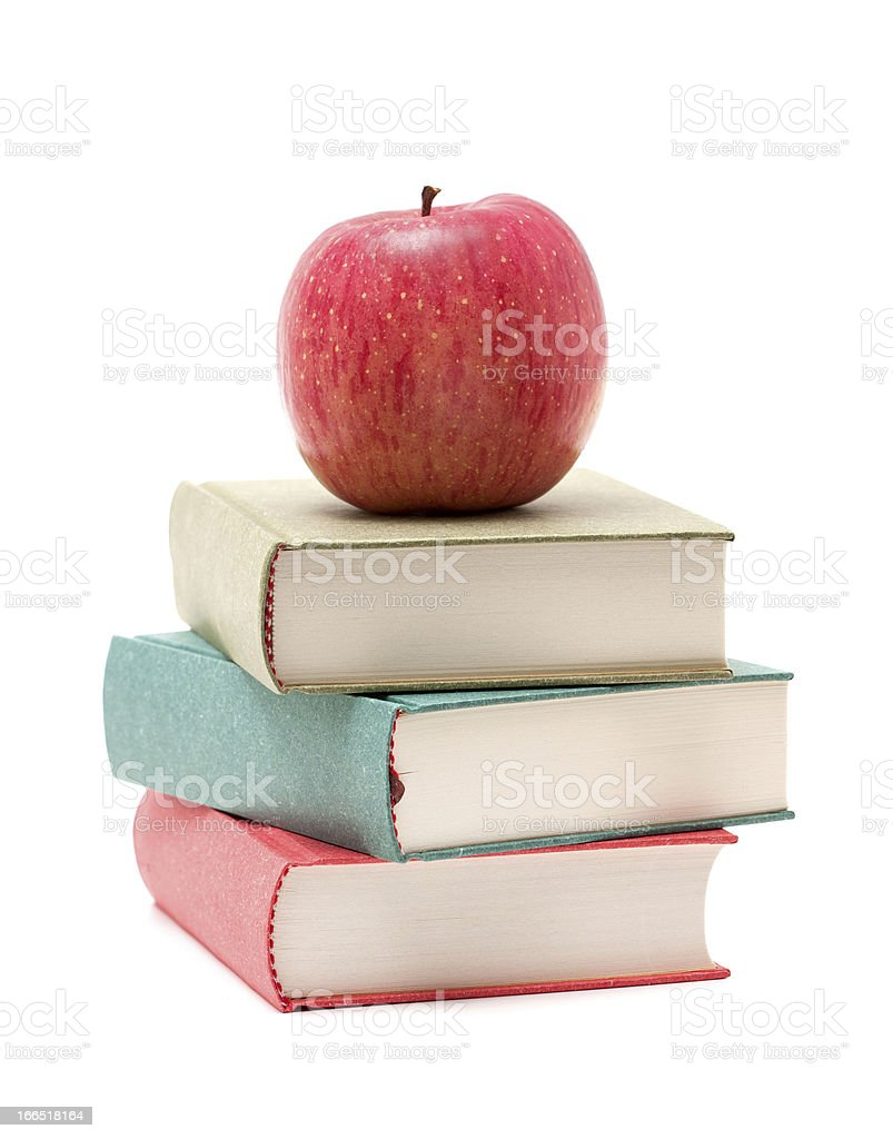 Apple on a Stack of Book isolated on white background stock photo